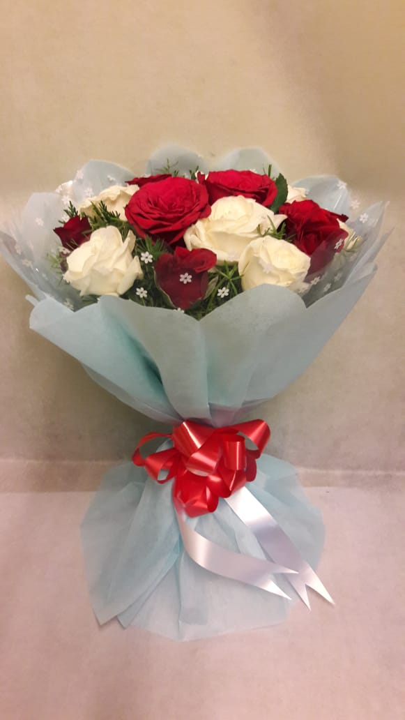 Red & White Roses in Blue Paper  cake delivery Delhi