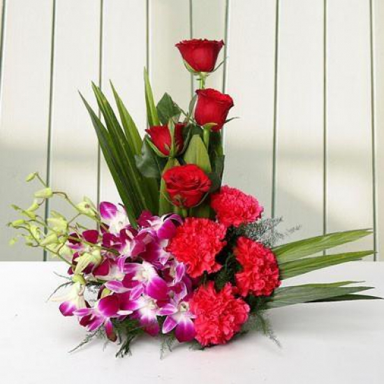Arrangement Carnations N Orchid cake delivery Delhi