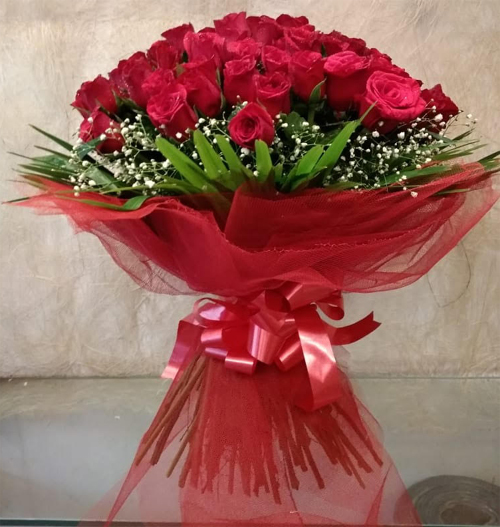 Bouquet of 50 Red Rose in Net Packing cake delivery Delhi