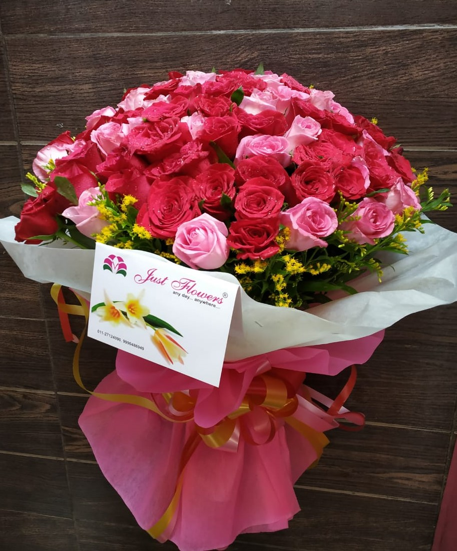 Pink Roses in Wrapped  cake delivery Delhi