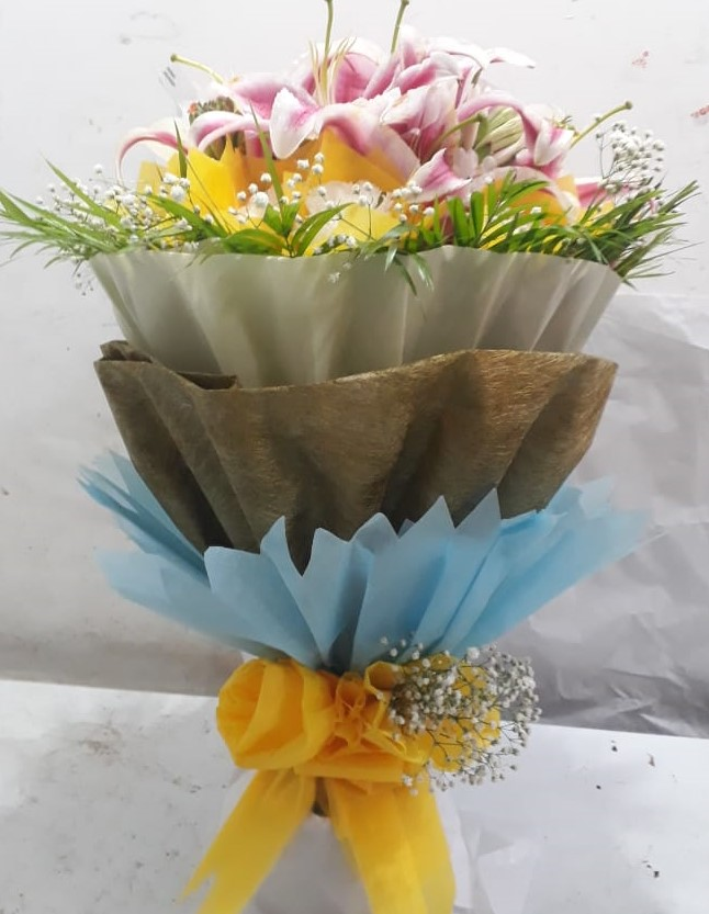 Bunch of 8 Pink Oriental Lillys in 3 Layer Packing cake delivery Delhi