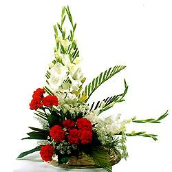 Arrangement of Red Carnation and white Glads cake delivery Delhi