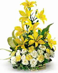 Lillium and Roses arranged in a Basket cake delivery Delhi