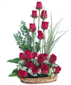 18 Red Roses arranged in a Basket cake delivery Delhi
