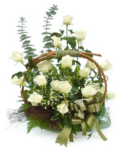 25 White Roses arranged in a basket cake delivery Delhi