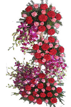 Three Tier Arrangement of mix exotic flowers cake delivery Delhi