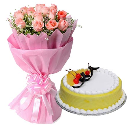 12 Pink Roses in Paper with 1/2kg Pineapple Cake cake delivery Delhi