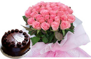 A hand bunch of 25 Red Roses and 1kg chocolate truffle cake cake delivery Delhi