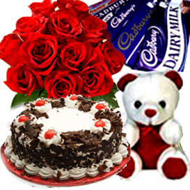 Bunch of 12 Roses, 1/2kg Cake, Chocolate and small teddy cake delivery Delhi