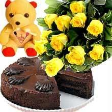 A bunch of 12 Roses with 1/2 kg Chocolate Cake and a cute Teddy cake delivery Delhi