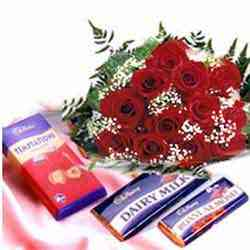 A bunch of 12 Roses with mix 10 regular pack of cadbury chocolate cake delivery Delhi