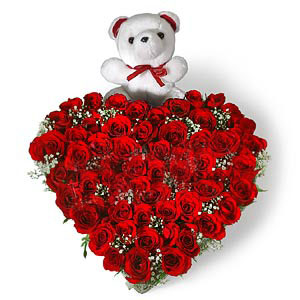 Heart Shape Arrangement of 50 Red roses with small cute teddy cake delivery Delhi