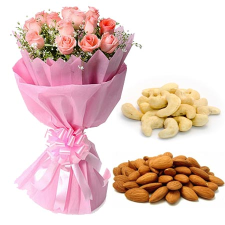 12 Pink Roses in Paper with 1/2kg Kaju & Almonds cake delivery Delhi