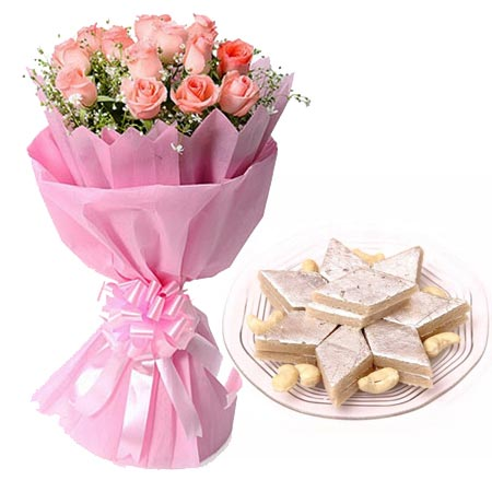12 Pink Roses in Paper with 1/2kg Kaju Berfi cake delivery Delhi